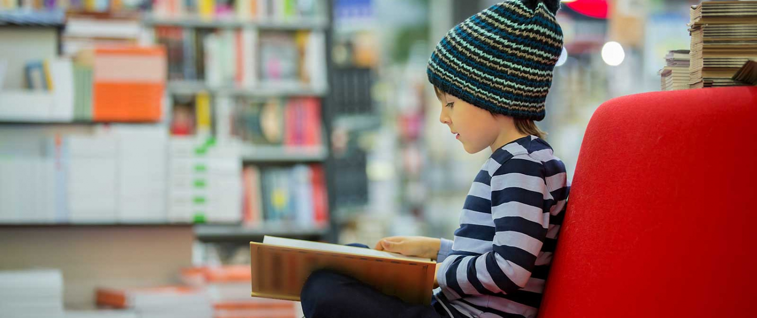 Child reading at a library
